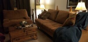 Kroehler brown micro fibre couch with two large throw pillows