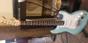 Blue and white Squier Fender Guitar