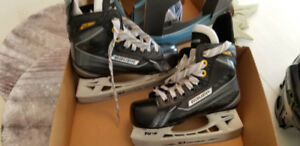 Boys Bauer ice skates size 12 and Bauer helmet Jr model 2100