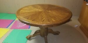 wooden extendable table with three chairs