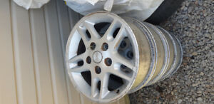"4 mags 16"" 5 trous  pour jeep grand cherokee 2000 a 200?..70$"