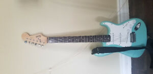 Blue and white guitar