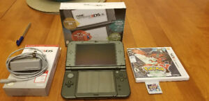 Nintendo 3DS XL with charger and Pokemon Y