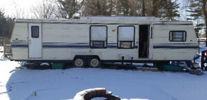1989 dutchman classic 35 foot trailer, at park ready to camp!