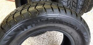 235/70R/16 WINTER CLAW EXTREME GRIP WINTER TIRES -LIKE NEW