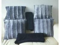 4 large cushions and 2large throws perfect condition £15 for the lot.