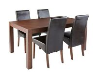 Beautiful Table with 4 leather look chairs - great condition