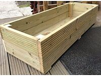 Brand new solid wooden planters. Unused. £40 each .