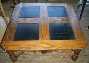 Large square solid coffee table with 4 inset tiles.