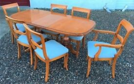 Extending dining table with 6 chairs. £85.