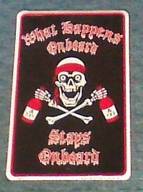 metal wall plaque, black, red and white, 'what happens onboard stays onboard'