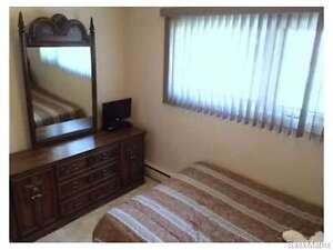 Double bed with dresser and mirror