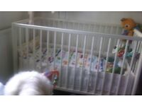 White cot, mattress, quilt, quilt cover pillow and bumper