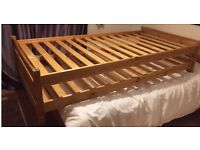 Stackable / nested single bed wooden frames.