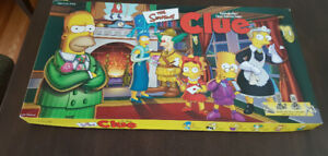 CLUE  THE SIMPSONS BOARD GAME.