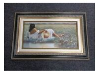 LARGE PICTURE DEPICTING GIRL RESTING IN FIELD & WITH BEAUTIFULLY ORNATE FRAME