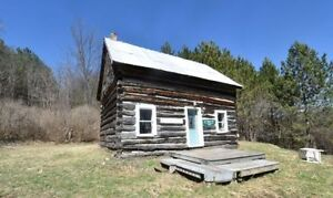 292 acres century log cabin 1km on Sunday Lake near Kingston
