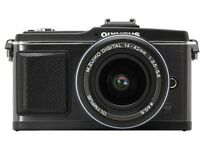 Olympus PEN E-P2 Black Body SLR Digital Camera with 3 lens kit, charger, and battery