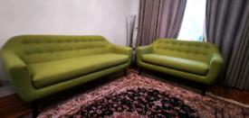 Two retro green sofas