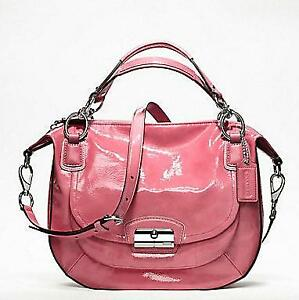 An Authentic PINK Coach patent Leather Handbag