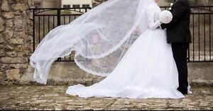Woman's white long sleeve wedding gown