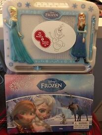 Brand new unopened Frozen Magnetic Drawing Kit plus 22 page Storybook. Perfect for Christmas.