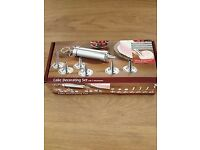 Cake Decorating set New and in box Has 7 differnet attachments