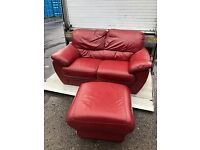 Red 2 seater sofa and footstool
