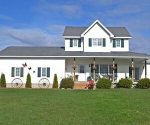 Spacious home with barn and 32 acres