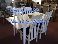 Extending White Wooden Dining Table With 4 Wooden Chairs