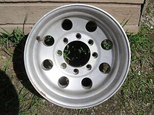 4 good truck rims 12.5- 8 bolt x 175