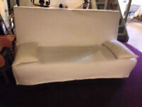 Futon like new IKEA with cover and pillows