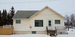 4 bedroom family home only a block from hospital in Melfort!