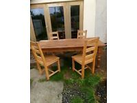Solid heavy table pine table with 4 chairs