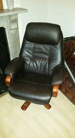 Leather Chair and Footstall. Used. One leg falls off when carried but it's fine otherwise.