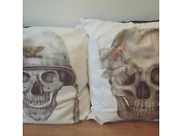 His and hers skull cushions