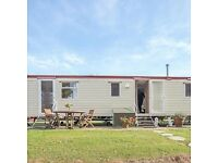 Lovely cosy caravan in Seton Sands three beds sleeps 8. All mod cons. Fireplace in lounge