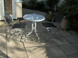 Bistro table and two folding chairs