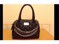 Black handbag with chain design
