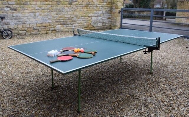 Table Tennis table- full size - complete with net, bats and balls.