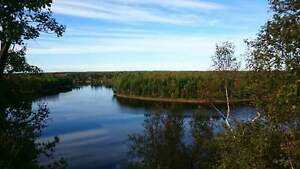 Shediac River waterfront house with income cottage on  property
