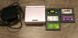 Gameboy Advance SP (001) and 5 games