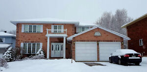 All brick two storey home overlooking ravine in P-Patch area
