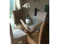 Oak and glass dining room table with four chairs