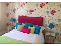 """Stunning Bright pink silk double bed headboard 4ft6"""" Good condition. Only used in show home."""