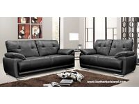 Black 2 and 3 seater leather sofa