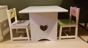 Table and 2 chairs, comes with play food and table setting for 4