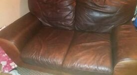3 n 2 seater leather sofas arms have sagged but loads of use left no rips but few scratches
