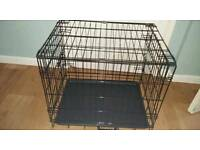 Metal pet cage with plastic bottom