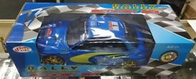 Radio controlled toy rally car